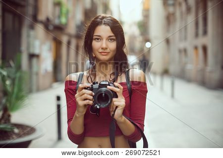 Attractive Tourist Woman Photographer With Dslr Camera Looking At Camera Outdoor In City Street In B