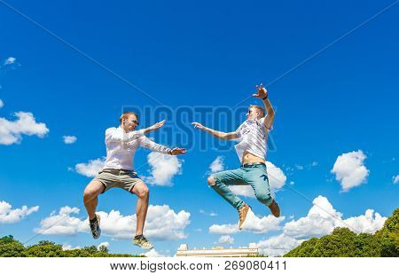 Guys Are Fighting In The Air. Guys Are Jumping Into Air And Kicking His Friend. Guys Are Fighting In