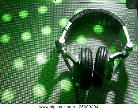 Dj headphones on party background