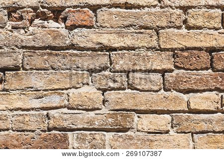 Horizontal Photo With Texture Of Wall. Wall Was Made From Bricks With Various Size. All Bricks Are W