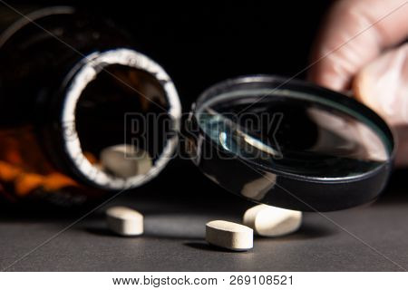 Quality Control Of The Drug Through A Magnifying Glass. Tablets May Illustrate Publications About Co