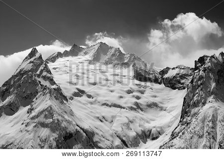 Snowy Glacier And Mountain Peaks In Clouds. Caucasus Mountains At Winter. Region Dombay. Peak Ine. V