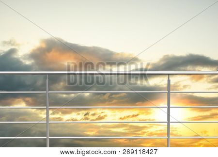 Chrome , Stainless Steel , Inox Or Alu Fence. Aluminum Fence With Sunset Clouds Sky Background. 3d I