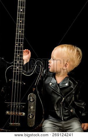 Sometimes Music Is All You Need. Rock And Roll Music Performer. Adorable Music Fan. Small Musician.