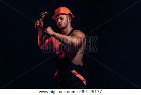 The Rest Being Still Under Construction. Muscular Man Builder At Work Under Construction. Hard Worke
