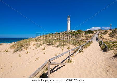Walkway With Sand Beach To The Lighthouse Of Trafalgar