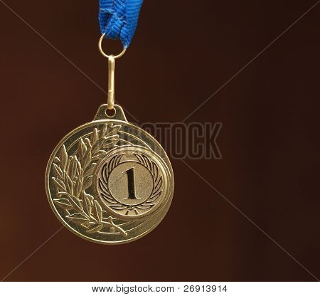 gold medal on brown background