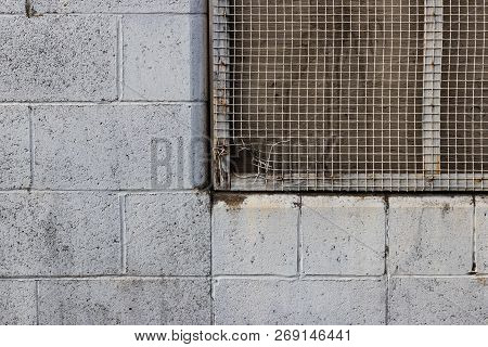 Old Rocky Wall With Chain Grated Window Hole