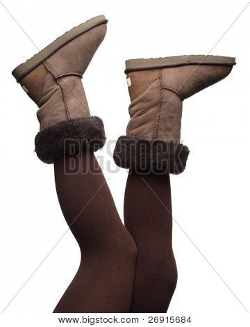 winter boots in the air, isolated