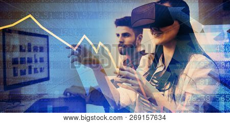 Stocks and shares against executive enjoying augmented reality headset at creative office
