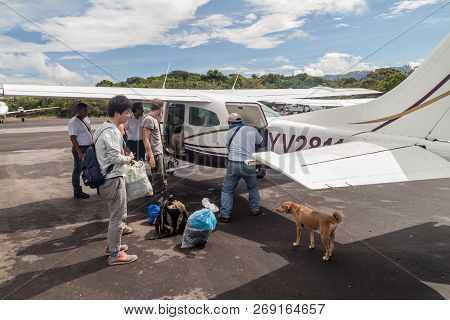 Canaima, Venezuela - August 16, 2015: Passengers Of Cessna 210 Centurion Airplane At The Airport In
