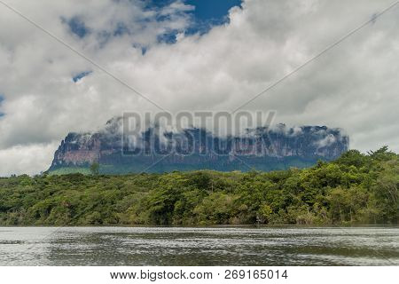River Carrao And Tepui Table Mountain Auyan In National Park Canaima, Venezuela.
