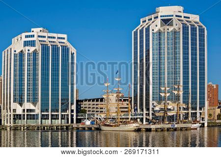 HALIFAX, NOVA SCOTIA, CANADA - AUG 20, 2009: Tall ships docked in the early morning on Halifax's waterfront at Purdy's Wharf during the Nova Scotia Tall Ship Festival.