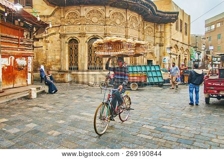 Cairo, Egypt - December 21, 2017: Traditional Bread Delivery In Old Town - The Cyclist With Large Wo