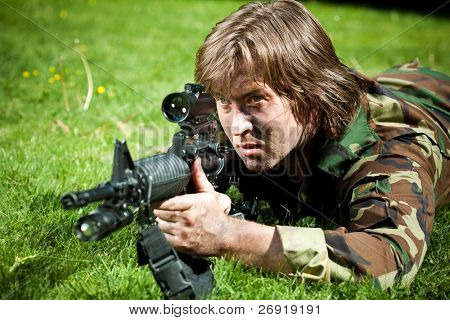 soldier aiming the rifle
