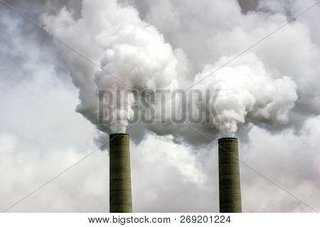 Coal Power Plant Smokestacks Emitting Pollution into Atmosphere poster