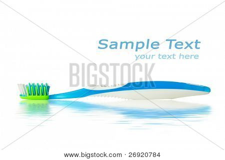 toothbrush with water reflection and copy-space