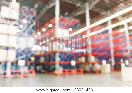 Defocused Warehouse Racks With Cartons Boxes As Background