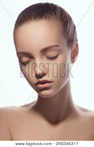 Front Portrait Of Beautiful Face With Beautiful Closed Eyes - Isolated On White. Close-up Fashion Po