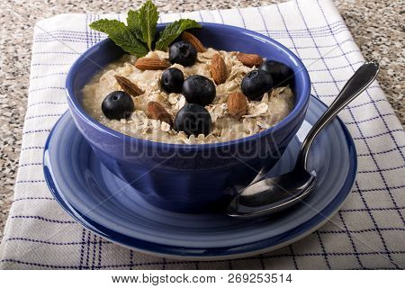 Porridge Made With Traditional Irish Oatmeal, Blueberries, Almonds In A Blue Bowl
