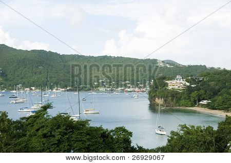 Port Elizabeth harbor with yachts sail boats tankers with view of Hamilton residences Princess Margaret Beach Bequia St. Vincent and The Grenadines in Caribbean Sea poster