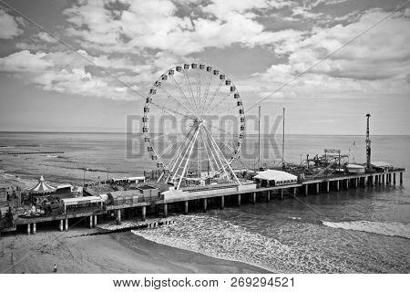 Amusement park rides on pier