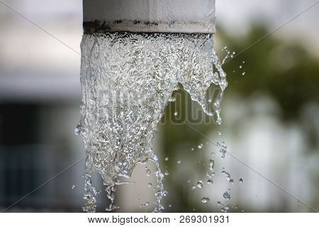 Raining. Water Flows Down The Pipe.