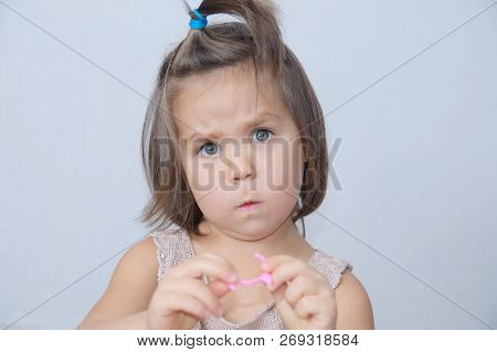 Surprised And Disconcerted Little Girl Portrait. Child Funny Face With Expressive Emotion. Emotional
