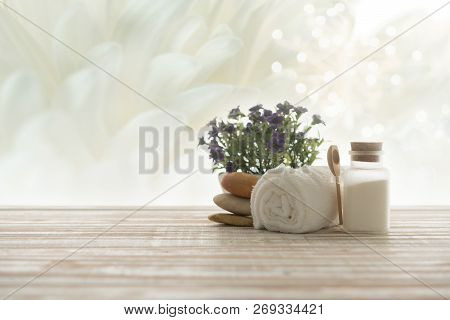 Spa Treatment Concept. Towel,salt Spa And Spa Stones With White Flowers Background