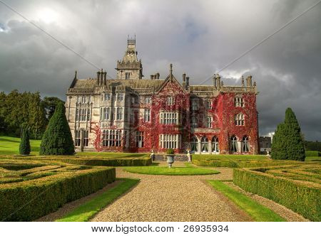 Adare mansion in red ivy in Ireland
