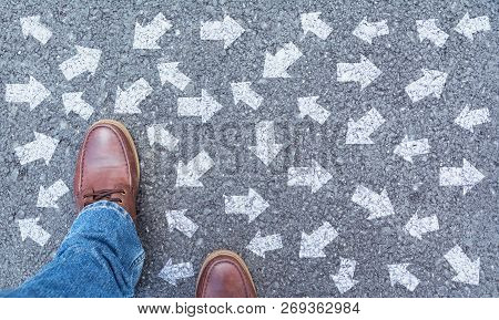 Top View Of Man Wearing Shoes Choosing A Way Marked With Arrows. Chooses The Right Path Concept.