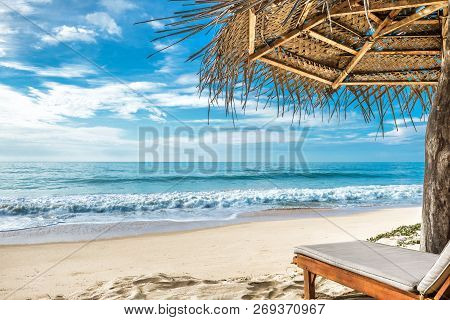 Tropical Beach With Bed And Umbrella. Beautiful View Of A White Sandy Shore And Sea In Tropics For B