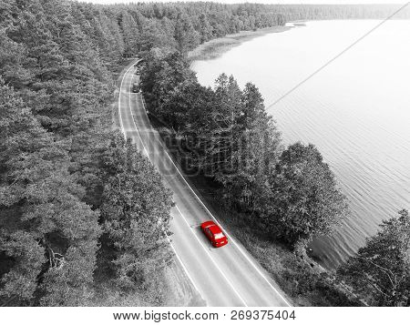 Aerial View Of Highway. Aerial View Of A Country Road With Moving Red Car. Car Passing By. Aerial Ro