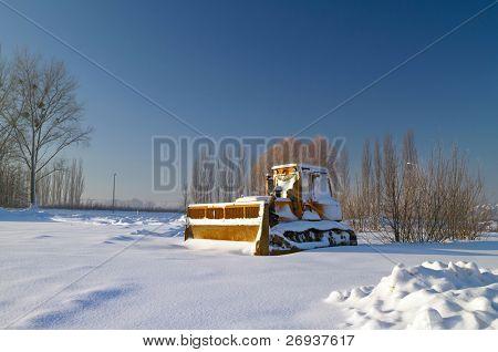 Bulldozer in snowy winter scenery