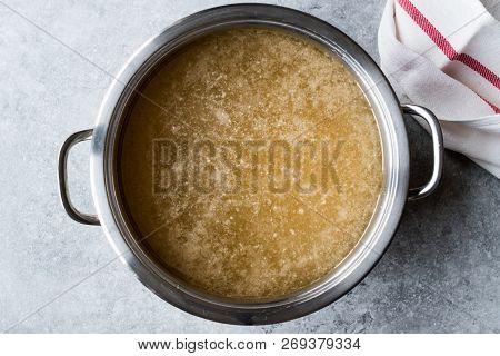 Bone Broth Bouillon In Metal Pan. Organic Food.