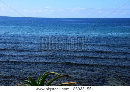 Mediterranean Panorama, With View From The Beach Over The Blue Mediterranean Sea On Sardinia At Hot