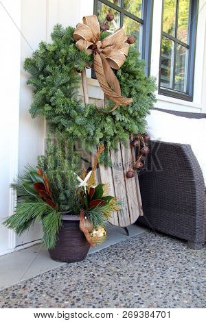Christmas wreath and vintage wooden sled decoration.