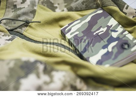 Military Clothing With A Bible On It.