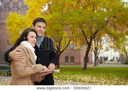 Couple On Vacation With City Map