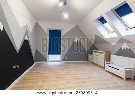 Kids bedroom with painted mountains on the wall