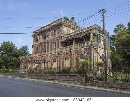 Greece, Corfu, Kerkyra Town, September 26, 2018: Old Classic Greek Abandoned Rundown Villa In Kerkyt
