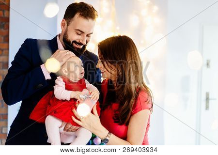 Woman Giving Christmas Present To Her Baby Child