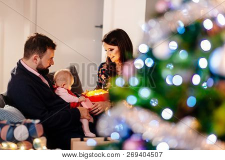 Family With Newborn At Christmas.