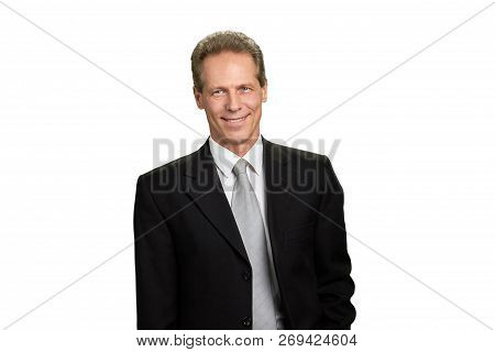 Portrait Of Smiling Mature Businessman. Middle-aged Caucasian Man In Black Business Suit Isolated On