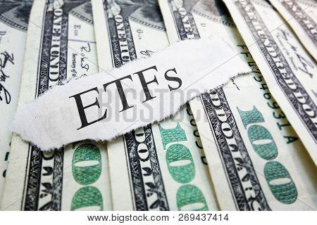 Etfs ( Exchange Traded Funds ) Newspaper Scrap On Assorted Money