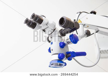 Image of a professional dental endodontic binocular microscope on a white background poster