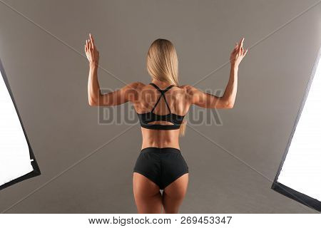 Strong Athletic Woman Fitness Model Posing Back Muscles, Triceps, Latissimus Over Black Background I