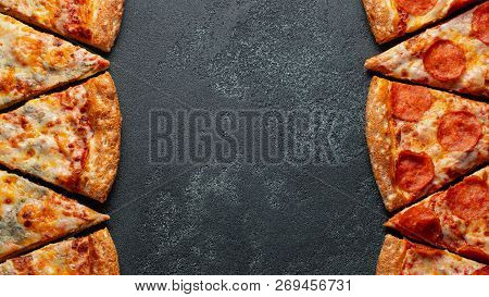 Cut Into Slices Delicious Fresh Pizza Pepperoni And Pizza Four Cheese On A Dark Background. Top View