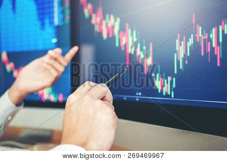 Business Team Trading Stocks Online Investment Discussing And Analysis Graph Stock Market Trading,st