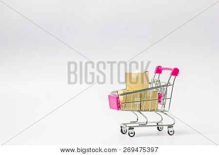 Online Market Place, Ecommerce Concept : Shopping Cart With Paper Carton Ready To Shop On White Back